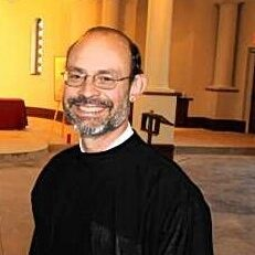 rick graefe/journals Nicky Antoniou, left, parish council president, and Father Douglas Papulis, head parish priest, are shown in the chapel of the new St. Nicholas Green Orthodox Church Family Life Center in Town & Country.